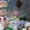thumbs colonel gaddafi Colonel Muammar Gaddafis Life In Photos: Women, Enemies And Fashion