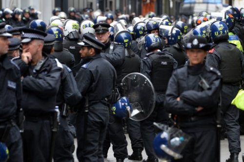 16778195 Photos: Police smash Soho squat to ruin G8 protests