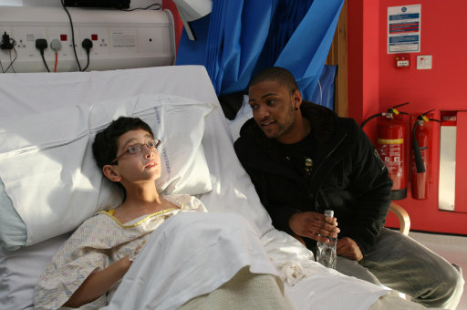 JB of JLS talks to Rene Ballesteros, aged 10, on the Rays of Sunshine Ward