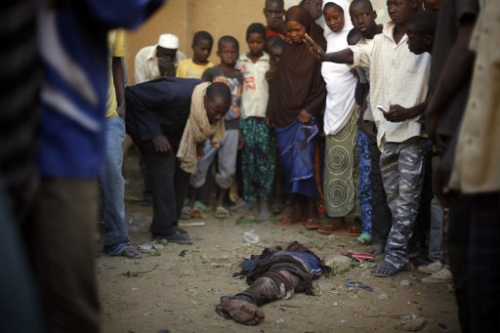 15768373 Happy Malians and the dead jihadis: the disgusting but wonderful war in photos
