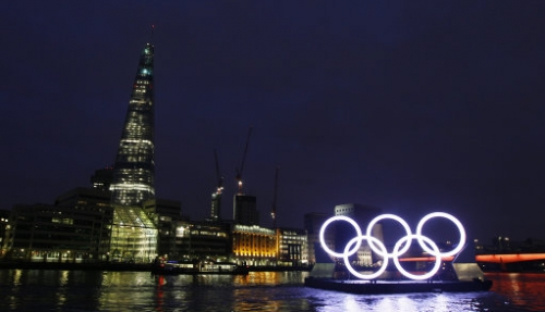 12912203 In photos: Olympic rings sail down River Thames