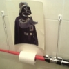 thumbs lightsaber toilet paper holder 580x435 Games and gadgets to play on the toilet