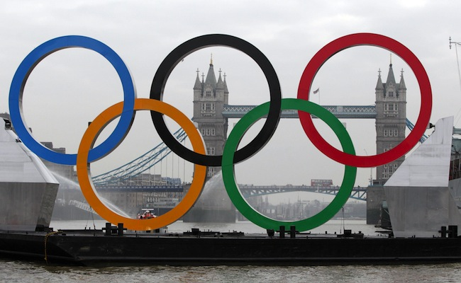 PA 12913947 In photos: Olympic rings sail down River Thames