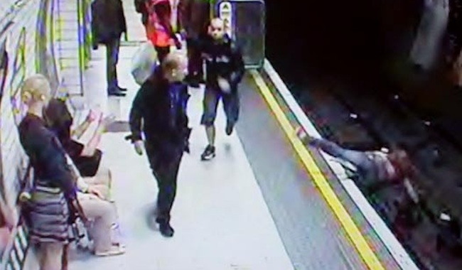 +CCTV+images+of+a+man+detectives+are+trying+to+identify+after+a+23-year-old+woman+was+pushed+onto+the+rail+tracks+at+Leicester+Square+Tube+station.