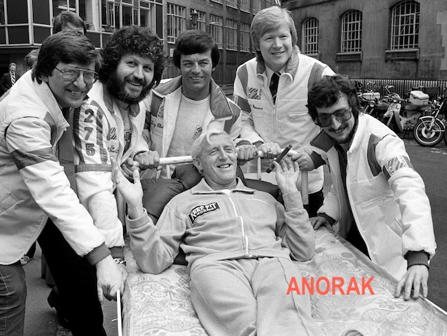 Radio One Disc Jockeys take time off to push Jimmy Savile from Broadcasting House to Park Lane by bed, in aid of the Variety Club of Great Britain and the Outward Bound Trust. (L-R) Simon Bates, Dave Lee Travis, Tony Blackburn, Kid Jensen and Steve Wright.