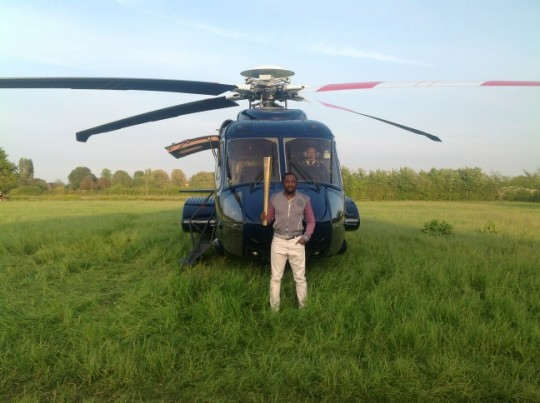 william helicopter High flying Will.i.am fights global warming with a day torch