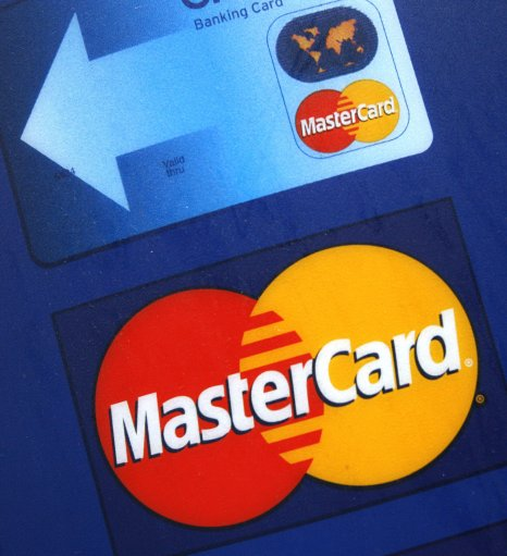 In this Dec.11, 2009 file photo, a sign for MasterCard credit cards is