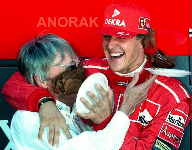 PA 7142862 Snapshot: Bernie Ecclestone and Michael Schumacher are sitting on a wall