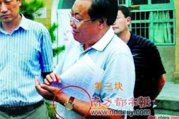 Smiling Chinese official in the mire over his expensive watch collection