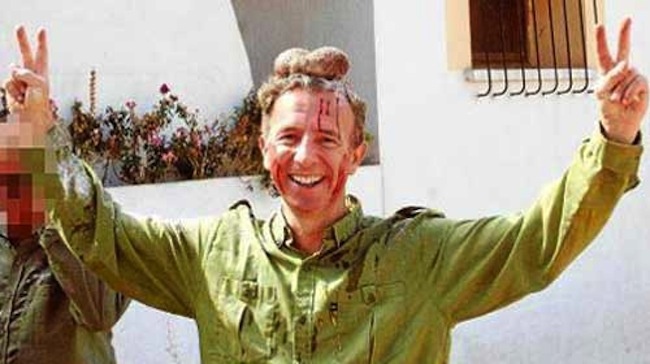 Carlos Delgado testicles Spanish toursim ministers poses with pair of bloody deer testicles on his head