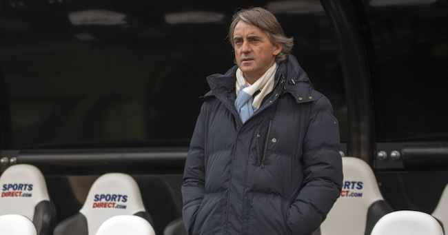 PA 15389545 Manchester City boss Roberto Mancini says he wont get sacked... which can only mean one thing