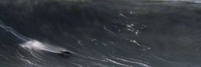 surfer portugal Surfer take a tumble in Nazare, Portugal: can he swim to safety? (video)