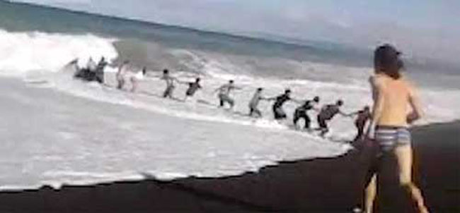 human chain new zealand Beach goers form human chain to save boy from drowning (video)