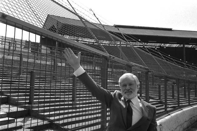 Ken Bates next to electric fence