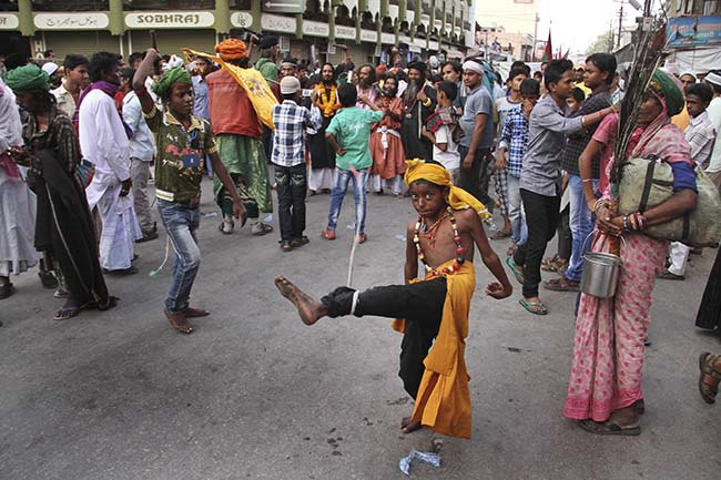 PA 16495722 In photos: Indian Muslim Sufi devotees use sharp objects and self flagellate during the Urs festival