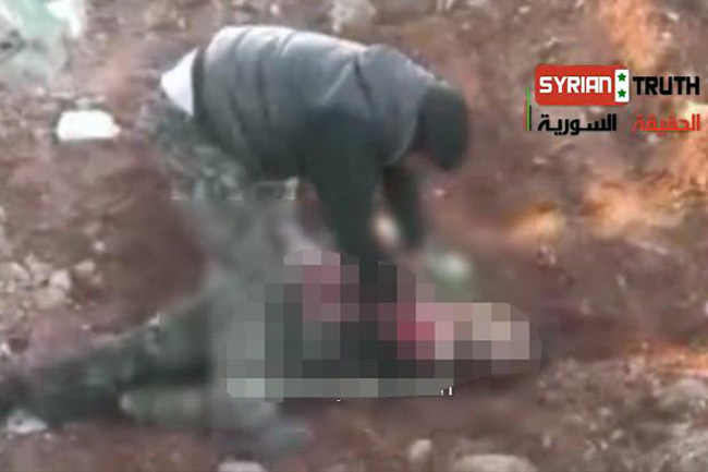 Syria heart As a Syrian rebel is filmed cutting out a soldier's heart we wonder who the hell the Free Syrian Army are?