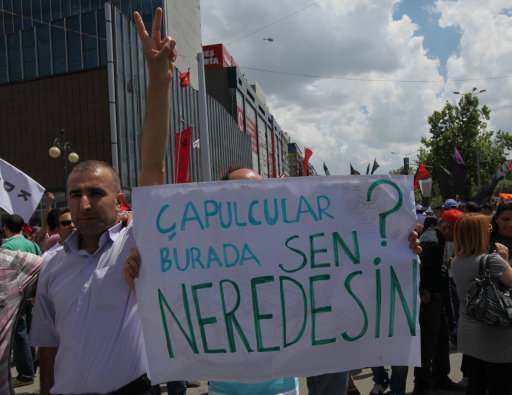 "A Turkish protester holds a banner that reads "" 'Looters' are here, where are you (Erdogan)""? as thousands of trade union members who are on a two-day strike march to Kizilay Square, Ankara, Turkey, Wednesday, June 5, 2013. In Ankara and Istanbul some demonstrations were largely jovial and humorous, calling themselves ""looters,"" asked Turkey's prime minister Recep Tayyip Erdogan to resign. (AP Photo/Burhan Ozbilici)"