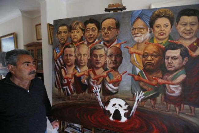Political painter Kaya Mar, 56, poses with a painting depicting the G8 world leaders, centre, 'plus five' leaders, right, pointing towards each other in blame for world problems as 'the planet is sinking' according to him at his home in London, Monday, June 10, 2013. The UK currently holds the one-year Presidency of the G8 group and leaders from Canada, France, Germany, Italy, Japan, Russia, USA and UK will meet at Lough Erne in Northern Ireland for the G8 Summit on June 17-18, 2013. Leaders from India, Brazil, China, South Africa, and Mexico will also attend. (AP Photo/Lefteris Pitarakis)