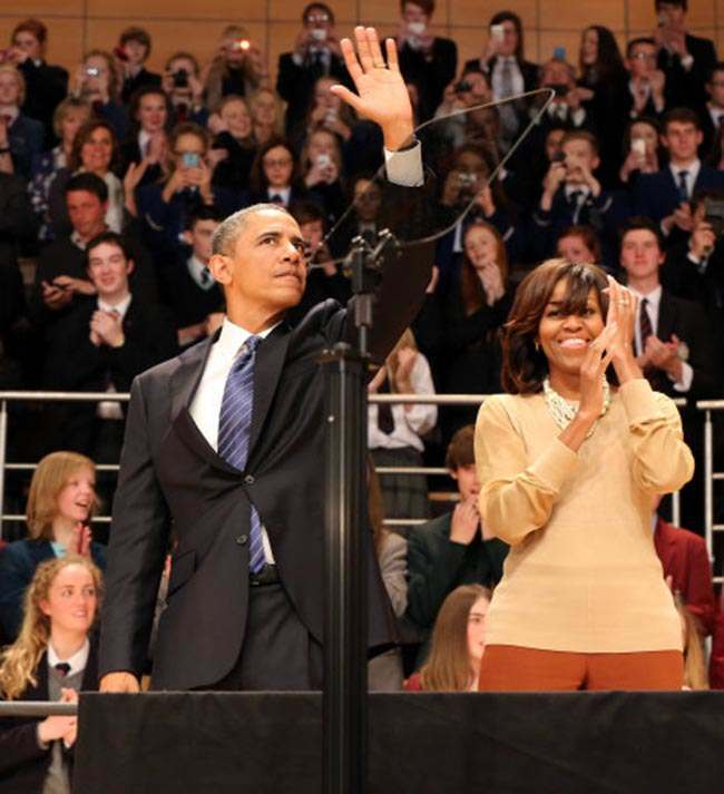 US President Barack Obama and his wife Michelle Obama, wave after he delivered a keynote address at Waterfront Hall in Belfast, ahead of the G8 Summit.