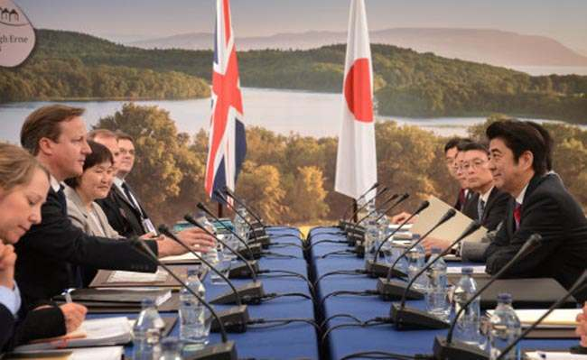 Prime Minister David Cameron (2nd left) holds a meeting with the Prime Minister of Japan Shinzo Abe (right) at this year's G8 Summit in Enniskillen in Northern Ireland.