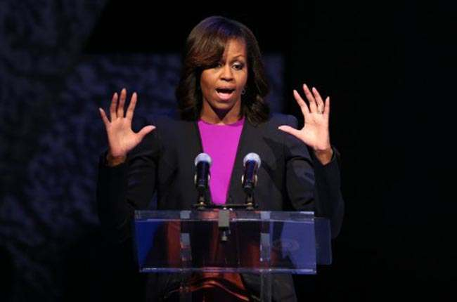 US First Lady Michelle Obama addresses the crowd on stage at the visit by her and her two daughters Malia and Sasha to the Gaiety Theatre, Dublin for a special performance of Riverdance.