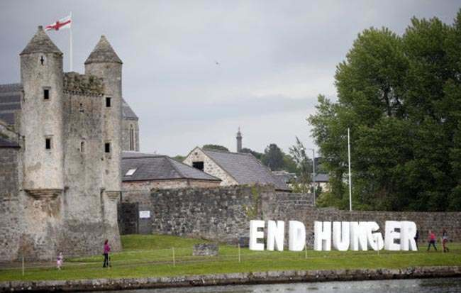 Giant letters are set up during a demonstration in front of Enniskillen Castle, outside of the security perimeter of the G-8 summit, in Enniskillen, Northern Ireland on Monday, June 17, 2013. The summit is taking place under heavy security, with some 7,000 police lining roads and checking vehicles. (AP Photo/Peter Morrison)