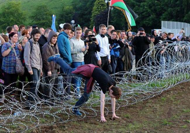 G8 Protesters break through an outer fence during a protest near the G8 summit in Loch Erne, Enniskillen.