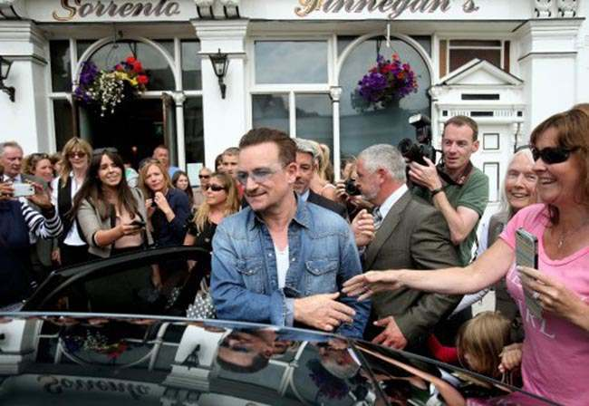 Irish musician Bono leaves Finnegan's Pub in Dalkey where he had lunch with the US First Lady Michelle Obama and his wife Ali.