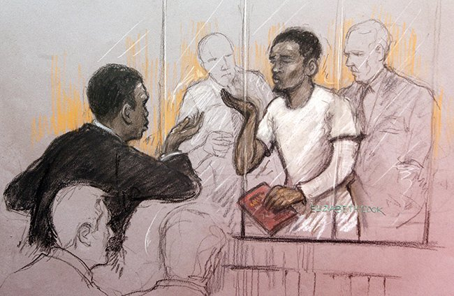 Court artist sketch by Elizabeth Cook of a member of the public gallery blows kisses at Michael Adebolajo in the dock at Westminster Magistrates Court, where he is accused of murdering soldier Drummer Lee Rigby and of the attempted murder of two police officers and possession of a firearm, a 9.4mm KNIL model 91 revolver, with intent to cause others to believe that violence would be used.