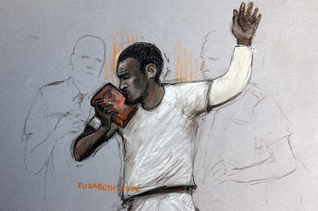 Court artist sketch by Elizabeth Cook Michael Adebolajo kissing the Koran, as he appears at Westminster Magistrates Court, where he is accused of murdering soldier Drummer Lee Rigby and of the attempted murder of two police officers and possession of a firearm, a 9.4mm KNIL model 91 revolver, with intent to cause others to believe that violence would be used.