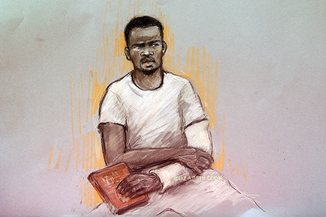 Court artist sketch by Elizabeth Cook of Michael Adebolajo in the dock as he appears at Westminster Magistrates Court, where he is accused of murdering soldier Drummer Lee Rigby and of the attempted murder of two police officers and possession of a firearm, a 9.4mm KNIL model 91 revolver, with intent to cause others to believe that violence would be used.