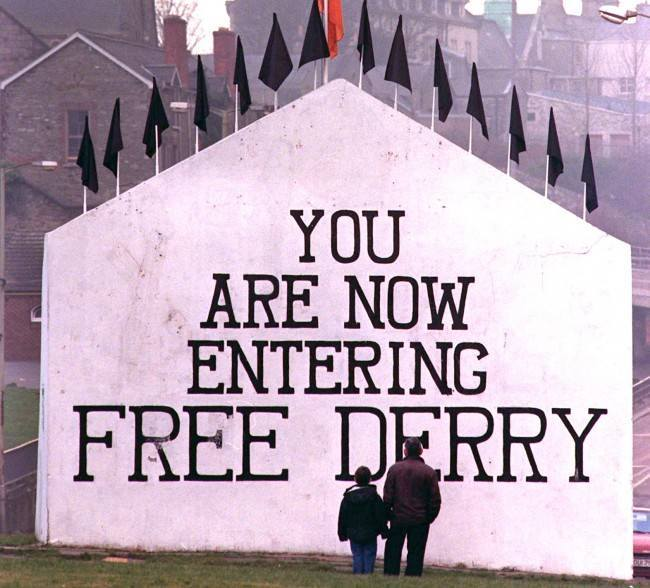 PA 1036123 G8 protestors erect this huge mural at Free Derry Corner