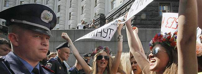 PA 10764451 FEMEN Faces: Photos of police officers expressions as they arrest topless feminists