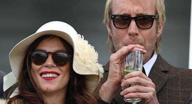 Actress Anna Friel and actor Rhys Ifans during Ladies Day of the Glorious Goodwood Festival at Goodwood Racecourse, Chichester.