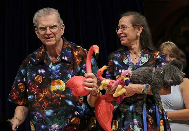 Artist Don Featherstone, 1996 Ig Nobel Prize winner and creator of the plastic pink flamingo lawn ornament, poses with his Nancy while being honored as a past recipient during a performance at the Ig Nobel Prize ceremony at Harvard University, in Cambridge, Mass., Thursday, Sept. 20, 2012. The Ig Nobel prize is an award handed out by the Annals of Improbable Research magazine for silly sounding scientific discoveries that often have surprisingly practical applications. (AP Photo/Charles Krupa)