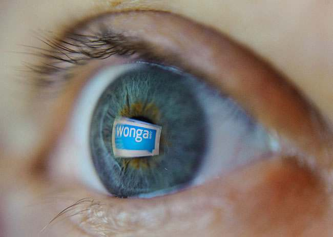 The logo of payday loan company Wonga is seen reflected in a woman's eye, as Wonga has entered the online payment industry by offering shoppers the option of borrowing cash to fund their web purchases.