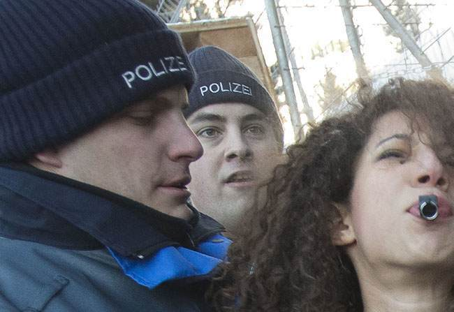 PA 15636727 FEMEN Faces: Photos of police officers expressions as they arrest topless feminists