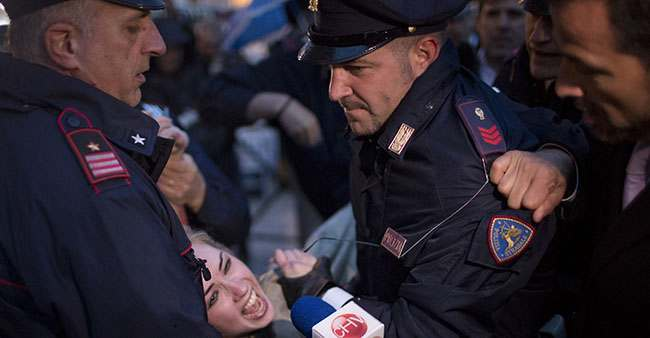 PA 16026600 FEMEN Faces: Photos of police officers expressions as they arrest topless feminists