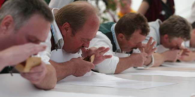 Competitors take snuff at the German Snuff Championships in Freihung near Nuremberg, southern Germany, on Saturday, June 8, 2013. The competition's aim is to snuff as much as possible from a five grams snuff package. (AP Photo/Matthias Schrader)