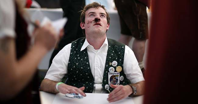 A competitor awaits the judges after he took snuff at the German Snuff Championships in Freihung near Nuremberg, southern Germany, on Saturday, June 8, 2013. The competition's aim is to snuff as much as possible from a five grams snuff package. (AP Photo/Matthias Schrader)