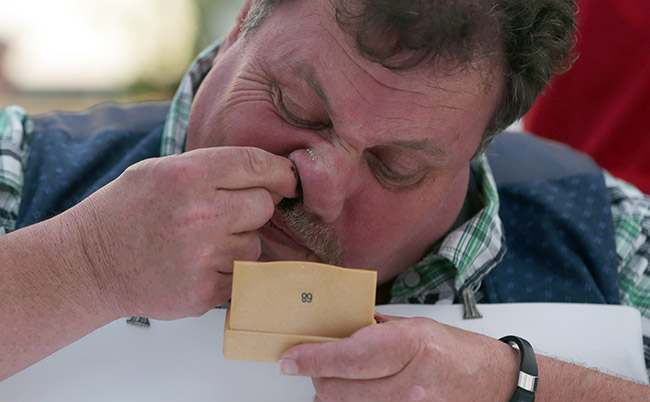 A competitor takes snuff at the German Snuff Championships in Freihung near Nuremberg, southern Germany, on Saturday, June 8, 2013. The competition's aim is to snuff as much as possible from a five gram snuff package. (AP Photo/Matthias Schrader)