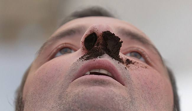 A competitor awaits the judges after he took snuff at the German Snuff Championships in Freihung near Nuremberg, southern Germany, on Saturday, June 8, 2013. The competition's aim is to snuff as much as possible from a five gram snuff package. (AP Photo/Matthias Schrader)