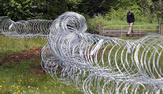 Razor wire is laid in fields near Lough Erne Hotel resort in Co Fermanagh, venue for next weeks G8 summit.