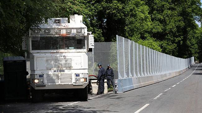 A Water Cannon passing miles of fencing erected around Lough Erne Hotel resort in Co Fermanagh, venue for next weeks G8 summit.