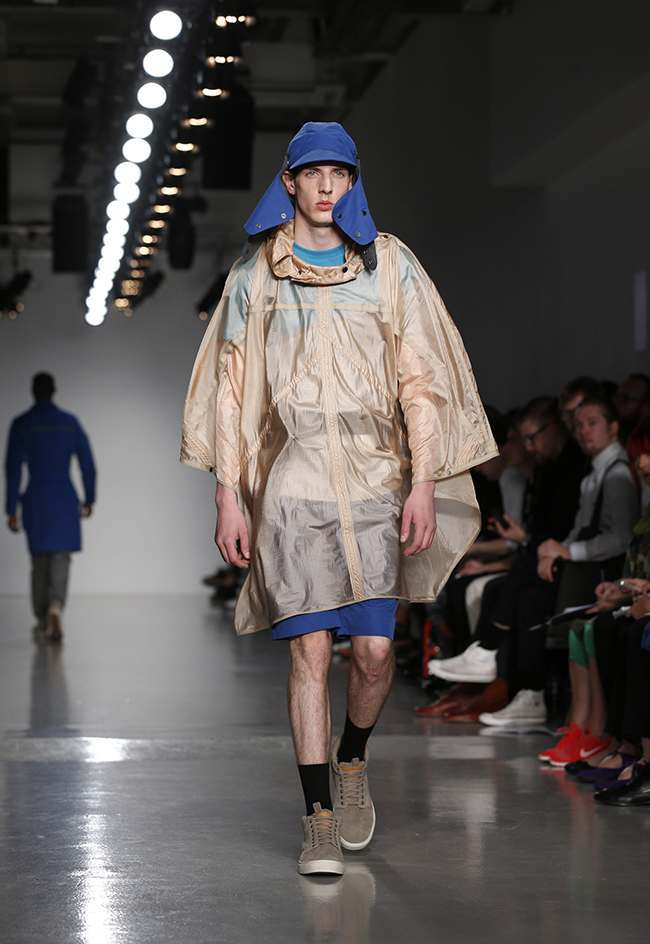 Models appear on the catwalk for the Christopher Raeburn Spring/Summer 2014 Menswear Collection show during the London Collections: Men event at Victoria House, London.