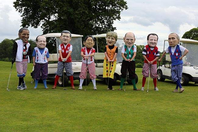 Puppets of (from left to right) US President Barack Obama, French President Francois Hollande, Canadian Prime Minister Stephen Harper, Japanese Prime Minister Shinzo Abe, German Chancellor Angela Merkel, Italian Prime Minister Enrico Letta, Prime Minister David Cameron, and Russian President Vladimir Putin at an IF campaign to highlight world hunger during the G8 Summit at Enniskillen Golf Club, Northern Ireland.
