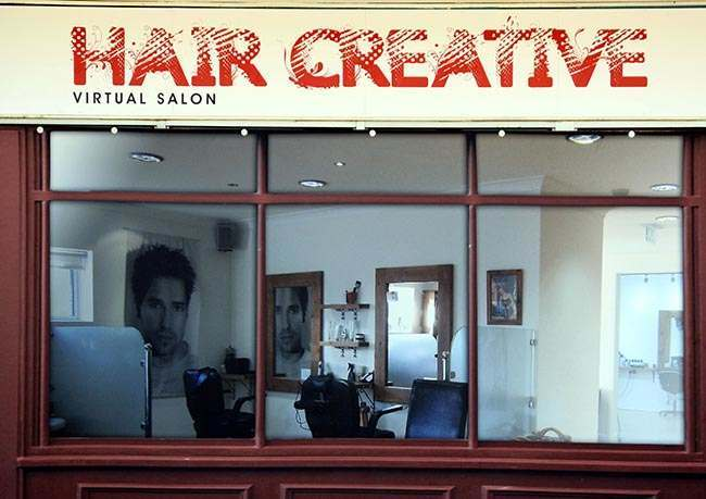 The 'Hair Creative' outlet at Coronation Square shopping centre in Hester's Way, Cheltenham as the owners of a struggling shopping centre have given it a new lease of life, by filling empty lots with fake shops.