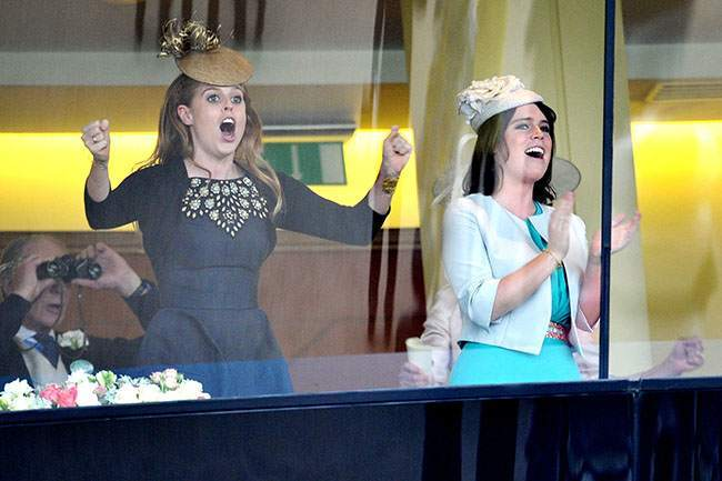 Princess Beatrice (left) and Princess Eugenie cheer as Britain's Queen Elizabeth II horse, Estimate, wins the Gold Cup on day three of the Royal Ascot meeting at Ascot Racecourse, Berkshire.