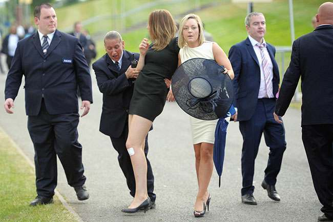 Racegoers are moved out of the road by security as they leave following day three of the Royal Ascot meeting at Ascot Racecourse, Berkshire. PRESS ASSOCIATION Photo. Picture date: Thursday June 20, 2013. See PA story RACING Ascot. Photo credit should read: Tim Ireland/PA Wire