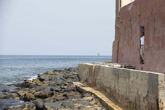 A woman is seen fanning herself through the 'Door of No Return,' during a visit by U.S. President Barack Obama to the slave house on Goree Island, in Dakar, Senegal, Thursday, June 27, 2013. Obama is calling his visit to a Senegalese island from which Africans were said to have been shipped across the Atlantic Ocean into slavery, a 'very powerful moment.' President Obama was in Dakar Thursday as part of a weeklong trip to Africa, a three-country visit aimed at overcoming disappointment on the continent over the first black U.S. president's lack of personal engagement during his first term.(AP Photo/Rebecca Blackwell)